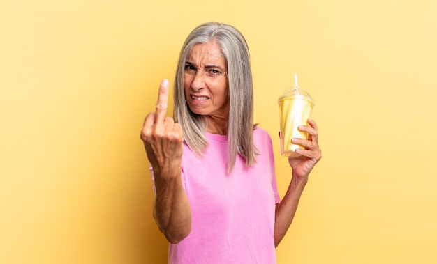 Feeling angry, annoyed, rebellious and aggressive, flipping the middle finger, fighting back and holding a milkshake