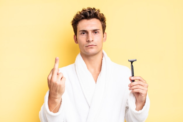 Feeling angry, annoyed, rebellious and aggressive, flipping the middle finger, fighting back. shave concept