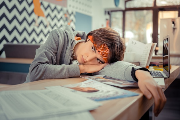 Feeling exhausted. the tired student laying on the desk