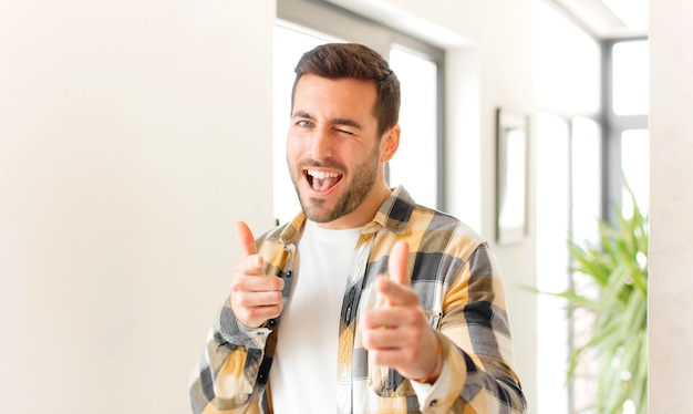 Feeling happy, cool, satisfied, relaxed and successful, pointing at front, choosing you