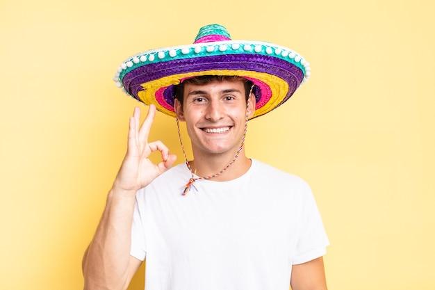 幸せ、リラックス、満足を感じ、大丈夫なジェスチャーで承認を示し、笑顔。メキシコの帽子の概念