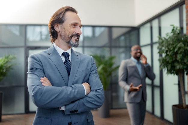 Feeling motivated. bearded grey-haired businessman feeling motivated before negotiation with partners