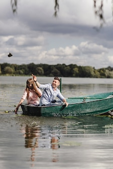 Feeling playful. beautiful young couple enjoying romantic date while rowing a boat.