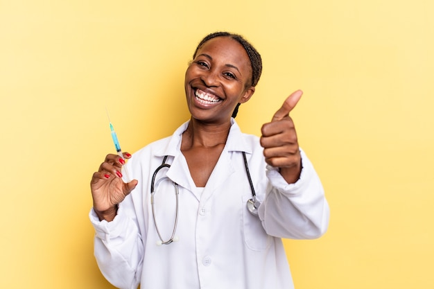 Feeling proud, carefree, confident and happy, smiling positively with thumbs up. physician and syringe concept