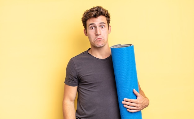 Feeling sad and whiney with an unhappy look, crying with a negative and frustrated attitude. yoga mat concept