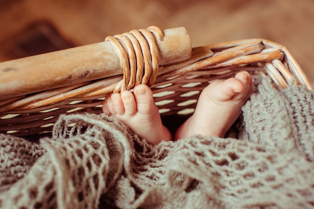 Feet of child lying in the basket