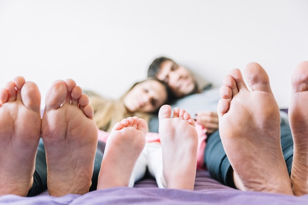 Feet of parents with their daughter