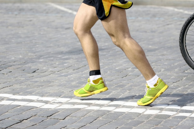 Feet running athlete on the course. sport and health