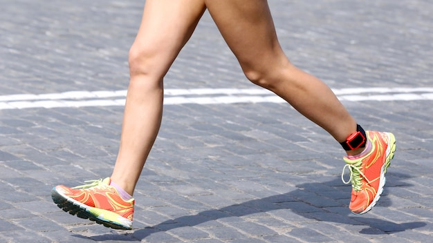 Feet running distance athlete on the stone pavement. sport and healthy lifestyle. desire to win. be the first in the competition.