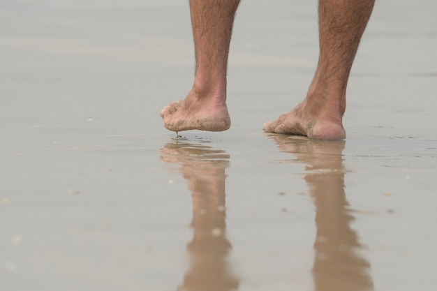 Feet walking on the water surface to relax