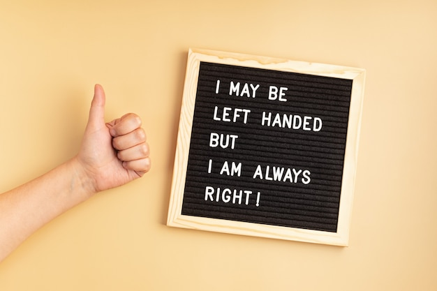 Felt board with text i may be left handed but i am always rightleft handers day concept