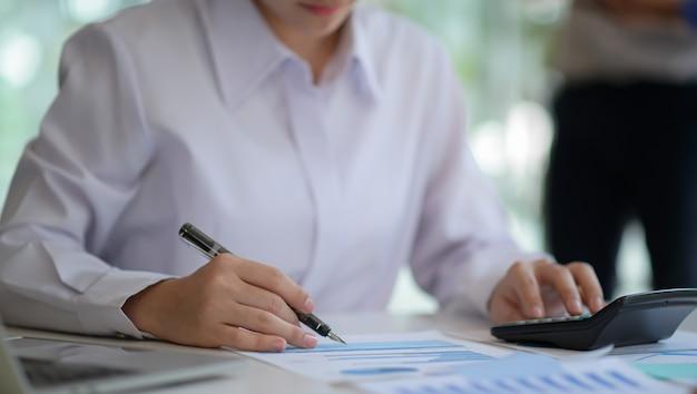 Female accountants are checking company revenue