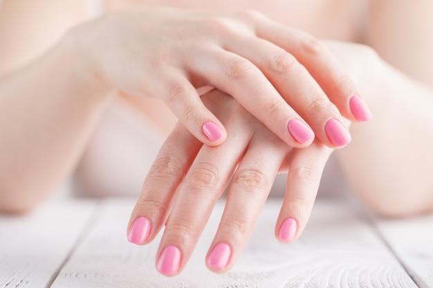 Female apply hand moisturizer cream