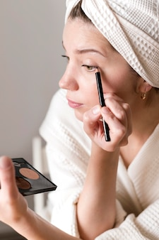 Female applying eyeliner
