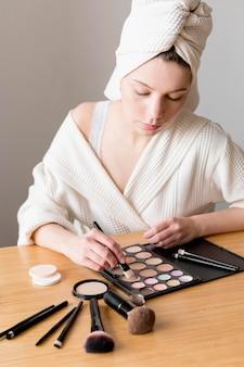 Female applying eyeshadow