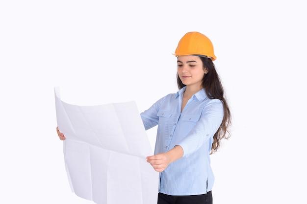 Female architect holding blueprint.