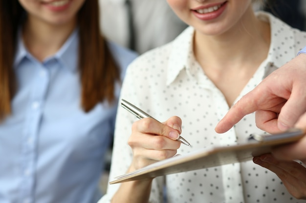 Female arm offer contract form on clipboard pad