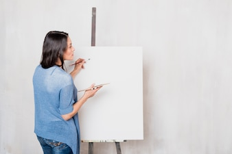 Female artist in front of canvas