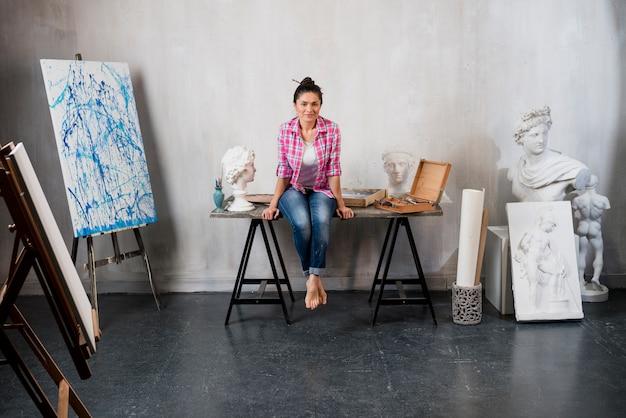 Female artist and sculpture