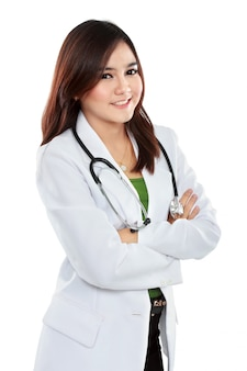 Female asian doctor wearing a white coat and stethoscope with arm crossed