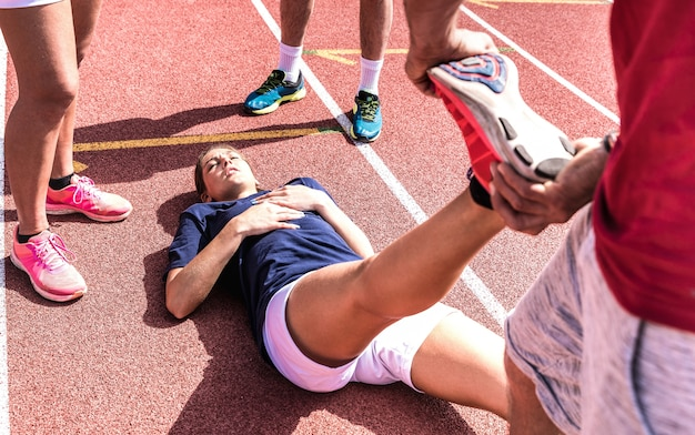 Female athlete injured on athletic run training - point of view composition
