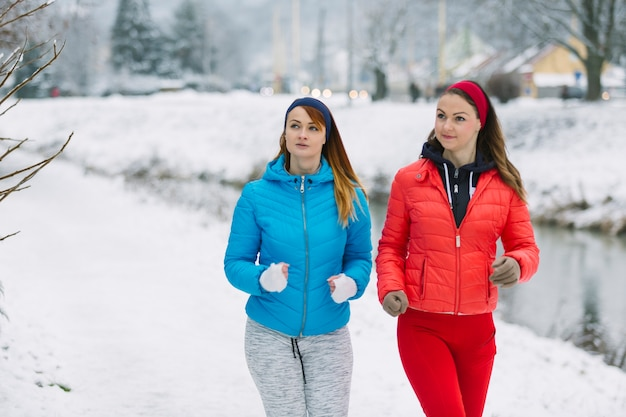 Female athlete jogging together in winter