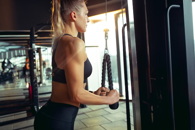 The female athlete training hard in the gym fitness and healthy life concept