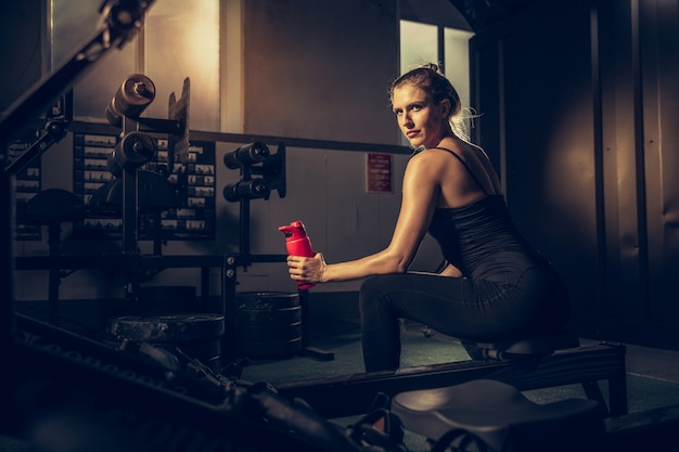 The female athlete training hard in the gym.