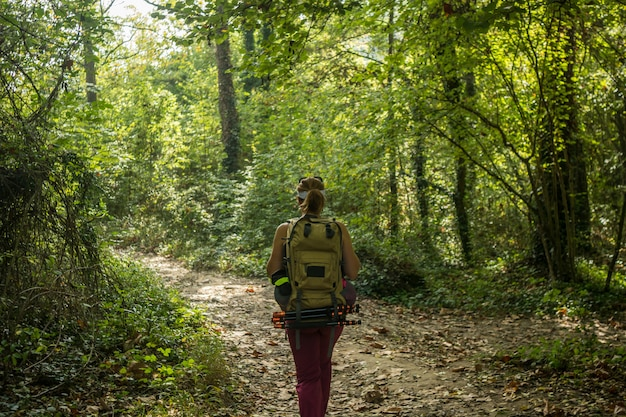 Female athlete to trekking through forests