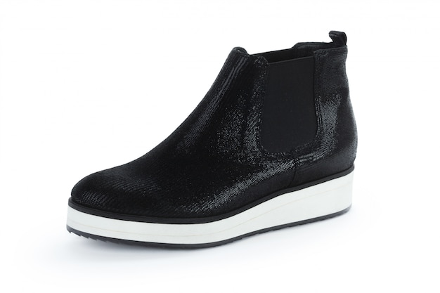 Female autumn-winter leather ankle  boots isolated on white
