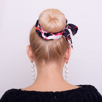 Female back with blonde hair style and fashion band