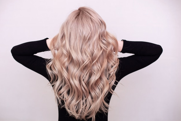 Female back with curly blonde hair