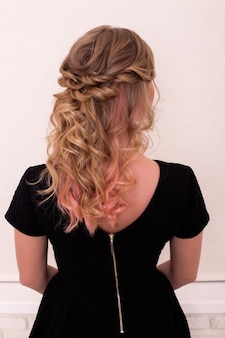 Female back with curly, ombre brunette hair