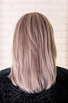 Female back with grey blonde hair