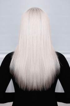 Female back with long straight blonde hair