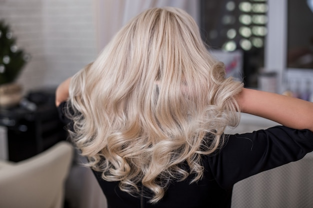 Female back with natural blonde hair