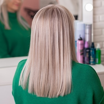 Female back with ombre blonde hair