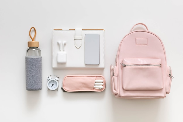 Female backpack stationery clothes student bag storage organization. concept of back to school
