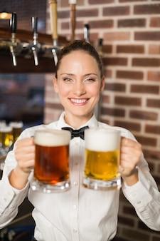 Female bartender holding beers