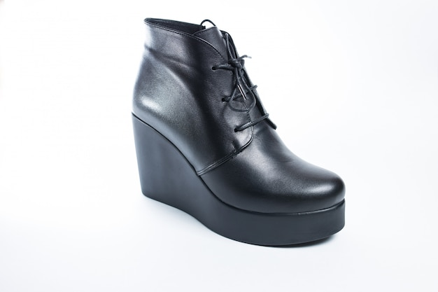 Female black boots isolated on a white background.