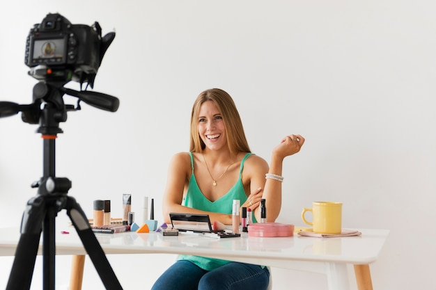 Female blogger filming tutorial at home