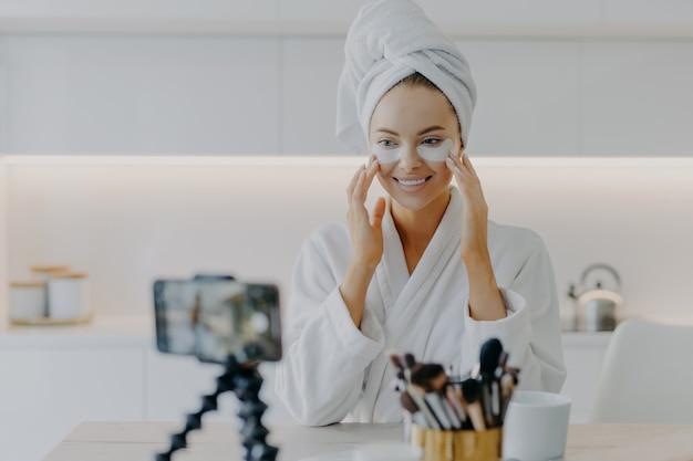 Female blogger recording a skincare video tutorial