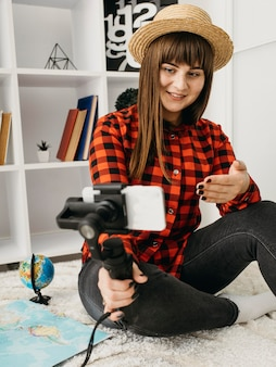 Female blogger streaming with smartphone