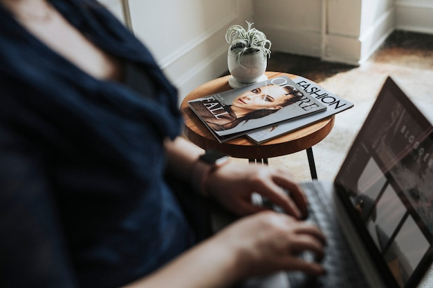 Female blogger using a laptop