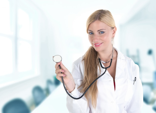 Female blonde doctor with stethoscope