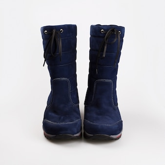 Female blue winter shoes over white