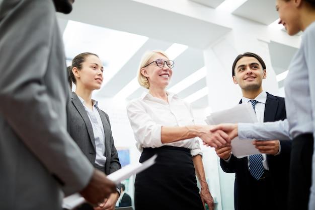 Female boss greeting partner