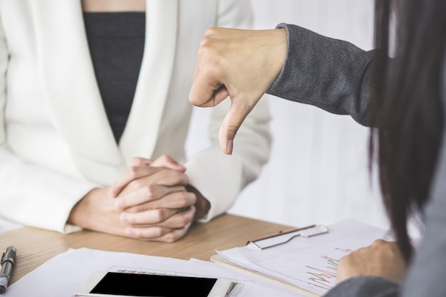 Female boss unhappy and disappointed with the project showing hand dislike to the team