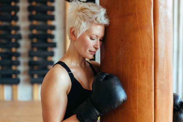 A female boxer and a boxing bag the concept of a strong woman