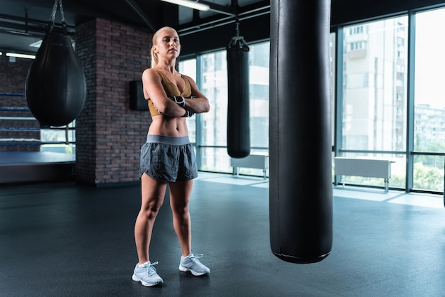 Female boxer. female boxer wearing nice white sneakers training hard before participating in competition